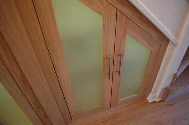 Understairs cupboards in white oak harrison fine for Door under stairs