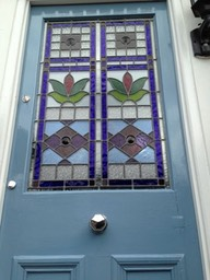 Stained glass reclaimed front doors.