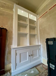 white alcove units with beaded doors