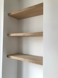 White oak floating shelves in alcove
