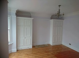White tradiational alcove wardrobes